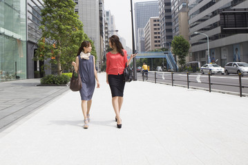 Young women who walk the business district