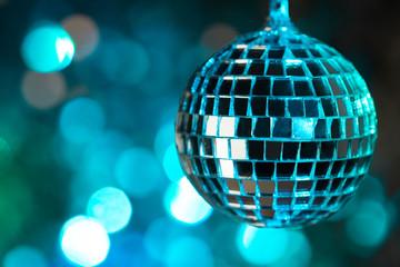 Blue disco ball on bokeh background - horizontal