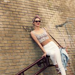 Beautiful stylish emotional brunette in sunglasses