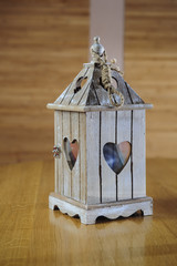 wooden candlestick with heart shape.