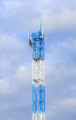 Worker working on communication tower