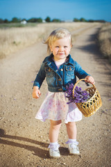 Little girl with lavender flower bouquet