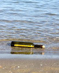 treasure map in the bottle on the shore of the ocean