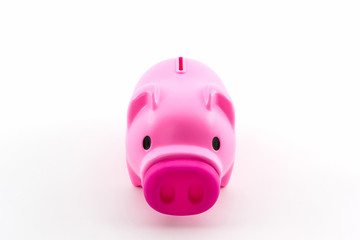 Pink piggy bank saving.