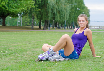 Young woman on roller skates in the park.