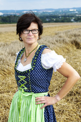 Portrait of woman in Dirndl on the field