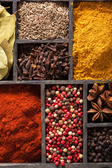 spices in box. pink black pepper paprika powder curry bay leaf a