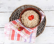 Big brown bowl with oatmeal and berries