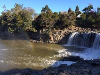 Haruru falls with a rainbow in new zealand