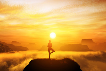 Woman meditating in tree yoga position on the top of a mountains
