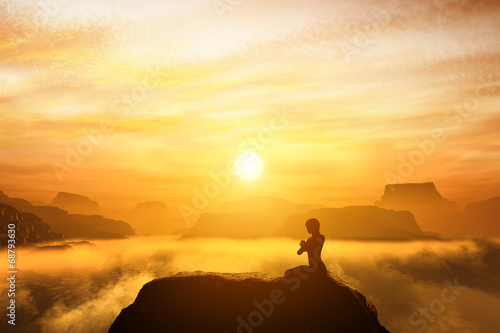 Leinwanddruck Bild Woman meditating in yoga position on the top of mountains