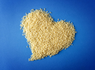 heart shape from pasta on the blue background