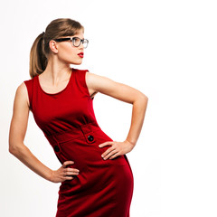 Fashion girl wearing stylish red dress and spectacles