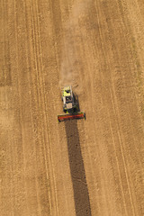 erial view of combine on harvest field