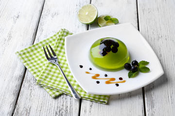 Green jelly with blackcurrant berries and sauce,