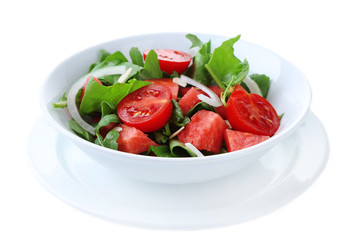 Salad with watermelon, onion, arugula and spinach leaves