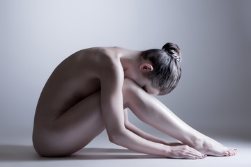 Nude model posing at camera. Concept of inner calm