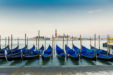 Gondolas moored by Saint Mark square with San Giorgio di Maggior