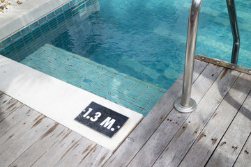Swimming pool with dept sign