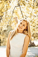 Autumn outdoor portrait of beautiful young blond woman