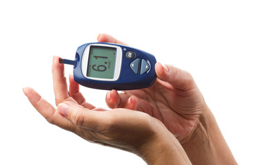 womans hand and glucometer