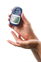 glucometer in woman hands