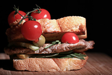 Italian toast with meat and tomatoes cherry