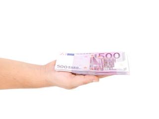 Man hand holding five hundred euro bills.