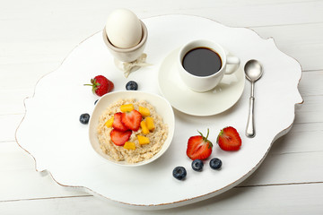 Delicious breakfast with coffee, egg and oatmeal