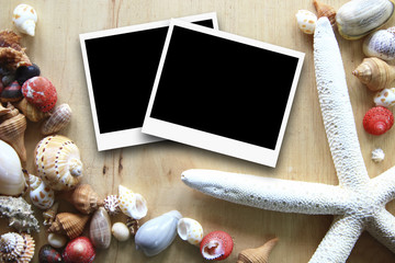 photo frames on the wooden background with seashells around