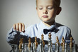 Little boy playing chess.5 Years Old Child.Chessboard