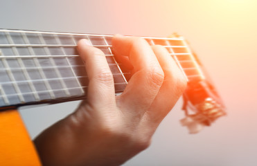 .Playing guitar