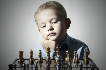 Little boy with chess.Smart kid.Little genius Child.Chessboard