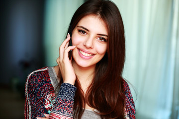 Portrait of a happy woman talking on the phone