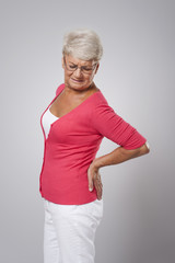 Senior woman with huge back pain