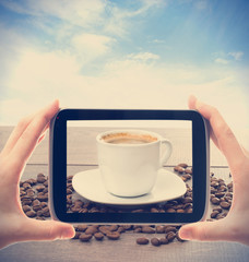 Photographing smartphone cup of coffee