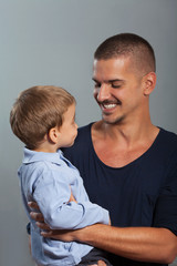 Portrait of young father and cute little son