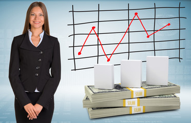 Businesswoman with white boxes and money