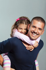 Portrait of young father and cute little doughter