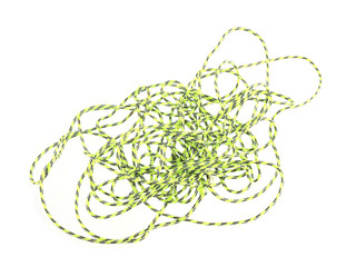 Close up photo of green string or twine on a white background.
