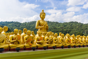 golden statue of monks and buddha