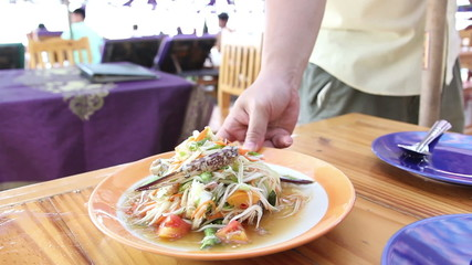 Serve papaya salad Som Tam at the restaurant beach