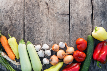 Fresh vegetables on vintage wooden background