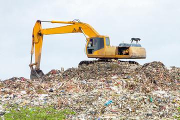 Crane scooping garbage