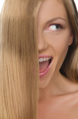 smiling woman with straight hair looks away