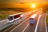 Two buses on highway in motion blur - 68806496