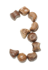 Number 3 arranged from chocolate sweets isolated