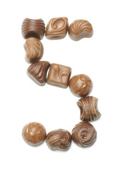 Number 5 arranged from chocolate sweets isolated