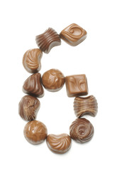 Number 6 arranged from chocolate sweets isolated