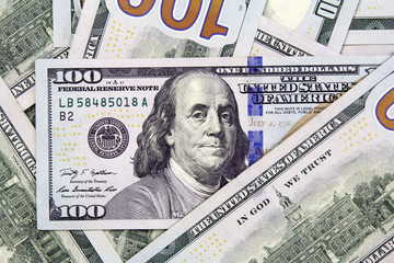 closeup of hundred american dollars banknotes